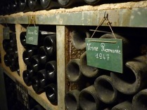 Vintage wines in the cellar at Corton André estate, Aloxe Corton